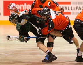 Owen Sound Quantum Properties NorthStars Mike McLeod, right, crushes St. Catharines Saints Mitch Dumont with a check during the NorthStars season opener at the Lumley Bayshore in Owen Sound in OLA senior lacrosse action on Saturday.(JAMES MASTERS The Sun Times)