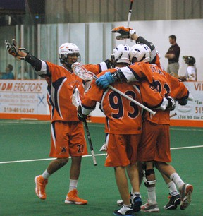 The Six Nations Arrows celebrate after Randy Staats' first goal of the game against the Brampton Excelsiors Sunday during Ontario Junior A Lacrosse League action Sunday at the Iroquois Lacrosse Arena. (DARRYL G. SMART Brantford Expositor)