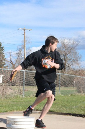 Jared Henderson of the MUCC Track Team tried his hand at discus during the mini-meet at Brownridge Field in Tisdale on Tuesday, May 14.
