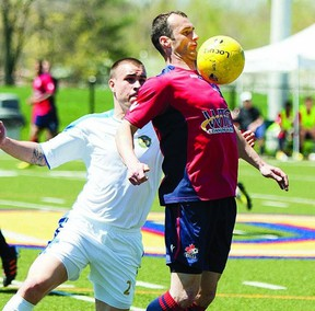 Kingston FC midfielder Catalin Lichioiu (16) redirects a pass off his chest from a teammate during the second half of the home opener against Brampton City United. Kingston defeated Brampton 6-2 in Canadian Soccer League action on May 5 at Queen's West Campus field.        ERIC HEALY - KINGSTON THIS WEEK