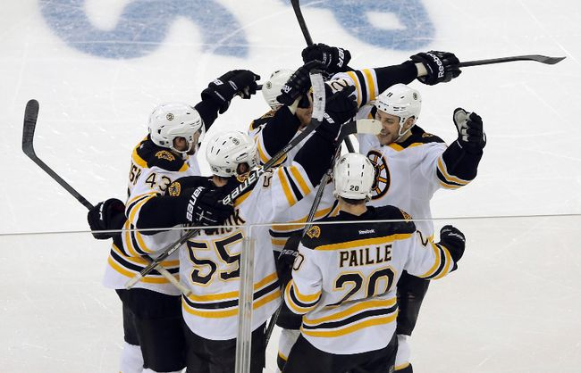 Boston Bruins players celebrate a goal by Johnny Boychuk (55) against the New York Rangers in the third period of Game 3 of their NHL Eastern Conference semi-final playoff hockey series in New York May 21, 2013. (REUTERS/Ray Stubblebine)