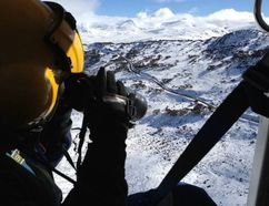 Rescue Crew Officer Luke Ashford uses a thermal imaging camera to search for a missing Canadian man in the Snowy Mountains in Australia's Kosciuszko National Park (Westpac Life Saver Helicopter/QMI Agency)