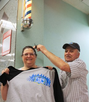 Timmins Canadian Cancer Society event co-ordinator Sandra Coupal got an idea of what those participating in Cops for Cancer will be feeling from Palace Barber Shop owner Roger Picard. The event, which will be held at the downtown Urban Park on June 27 aims to raise money to fund cancer research and programs supporting local residents affected by the disease.