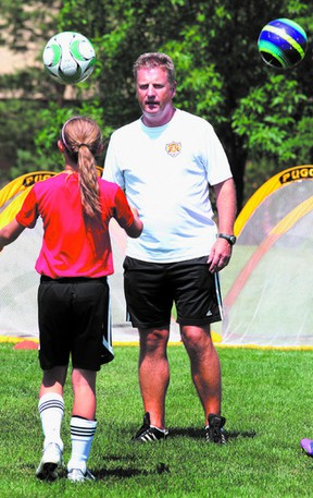 Team Canada U-17 men's soccer coach Sean Fleming instructs young players during a kid's camp in his native Sherwood Park last summer. Photo by Perry Mah/QMI Agency