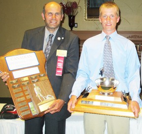 Paul Dodds and Kevin Haney hold their trophies after winning top senior plowman and top junior plowman at the Canadian Plowing Championships at Abbotsford, B.C. earlier this month.