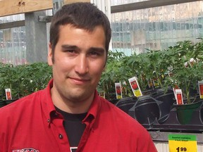 Pierre Touchette, garden centre manager at Canadian Tire in Portage la Prairie, stands near a large selection of tomato transplants to suit every gardener's need from cherry size to large slicers. (TED MESEYTON/SUBMITTED PHOTO)