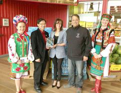 The Parkland Ukrainian Dancers Society are presented with a plaque commemorating their 30-year anniversary. - Photo Submitted