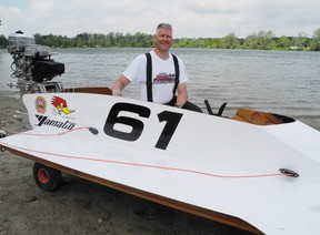SARAH DOKTOR Simcoe Reformer Erik Luksep of Toronto stands beside his boat at the Waterford Conservation Area on Sunday. The Toronto Outboard Racing Club held races in Waterford over the weekend.