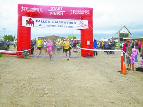 The first set of runners in the Fallen 4 Marathon burst through the starting gate at the Fallen Four Memorial Park in Mayerthorpe at 7 a.m. on Sunday, June 2.