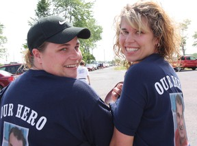 ALS walk co-ordinator Melissa Ferguson and Amanda Mayer pay tribute to Peter Ferguson, who was diagnosed with the disease at age 32, during last year's fundraising walk. This year the event is scheduled for Saturday, June 8, at St. Lawrence College. File photo