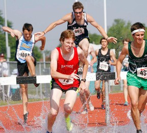 Bayside Red Devils' Adam Doxtator competes in the open men's 2,000m steeplechase race at the East Regional Track and Field championships last Friday at Belleville's M.A. Sills Park.