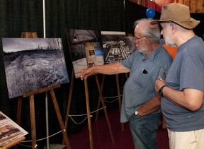 Bill Stevens and Gary Van Dorp look at some old photos of Vanastra before the BR and E presentation.