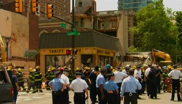 Rescue workers search through rubble following a building collapse in Philadelphia June 5, 2013, as seen in this still image taken from video courtesy of NBC10.com.    REUTERS/NBC10.com/Handout