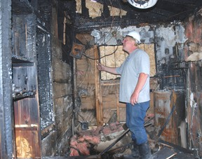 Ken Parks of Onside Restoration inspects the damage in a West Lorne home where a fire started last week.