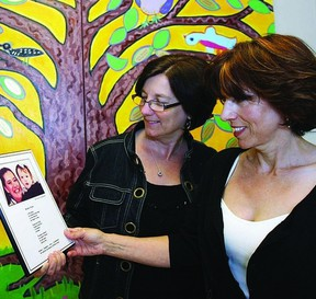 Joanne Young, executive director for Kingston Interval House, (KIH) and Cristina Duchesneau, vice-chair on the board of directors, look at a portrait of Robin and her granddaughter, for whom Robin's Hope, KIH's transitional housing facility is named. The two were busy planning the upcoming Butterfly Ball fundraiser for KIH, which is taking place at the Renaissance Event Venue on June 6.     ROB MOOY - KINGSTON THIS WEEK