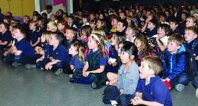 Students at Academie catholique Ange-Gabriel react Thursday to watching a video of Montreal where, minutes later, 20 students found out they would be going for a wrap up of the Get up and Move! challenge. (DARCY CHEEK The Recorder and Times)