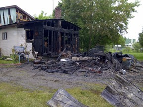 Fire destroyed a garage at this County Road 43 home Saturday and caused extensive damage to the residence.