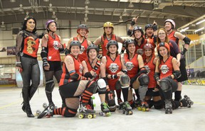 The Headstone Honeys and their mascot Satina Loren gather for a group photo following the Honeys home opener against the Nodak Knockouts from Minot, ND. The team was able to secure a win in front of the home crowd with a final score of 251 to 120. (Submitted photo by John Kushniruk)