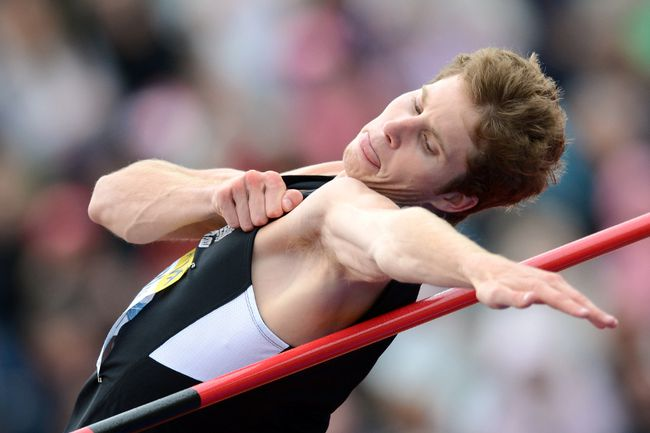 Corunna's Derek Drouin has been named Big Ten Athlete of the Year after winning his seventh overall Big Ten high jump title and his fourth outdoors title. He's pictured here last July at the 2012 Diamond League athletics meet at Crystal Palace in London, England, where he won with a jump of 2.26. AFP PHOTO/ADRIAN DENNIS