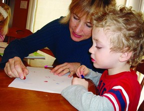 Marianne Hall, occupational therapist, works with junior kindergarten student Felix Wilson during one of her handwriting classes.       Contributed photo