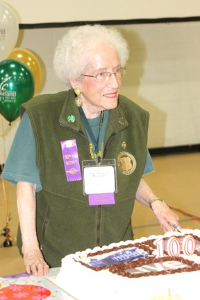 Jo Berglund (class of '39) cuts the cake Saturday afternoon at the Lakeland College homecoming celebration.
