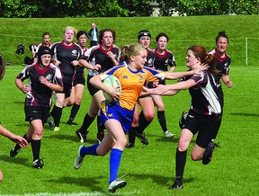 The Bev Facey Falcons won their second consecutive Metro Edmonton League Premier Conference senior girls rugby title with a 42-12 victory over the Bellerose Bandits. Photo by Shane Jones/Sherwood Park News/QMI Agency