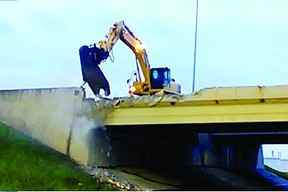 Demolition crews work to take down the eastbound Baseline Road bridge over the Anthony Henday (Highway 216) last month. Photo Supplied