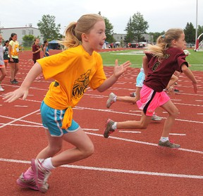Atom girls take off for the finish line in a 100 metres heat during Thursday's Limestone elementary schools track and field championships at the Invista Centre's Caraco Field. Michael Lea The Whig-Standard