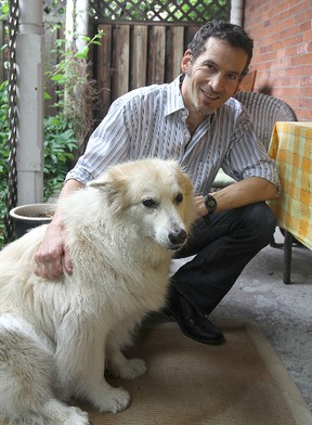 Kingston author Steven Heighton, with his dog Isla. Michael Lea The Whig-Standard