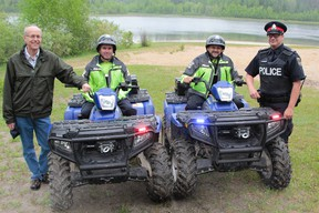 Timmins Police and the Mattagami Region Conservation Authority put out the message this week that Hersey Lake Conservation Area is a family place, not a venue for beach beer parties. Taking part in the news event was, left to right,  MRCA manager Kees Pols,  Timmins Police Constables Paul Colbey,  Brad Palmer and David Ainsworth.  Timmins Times LOCAL NEWS photo by Len Gillis