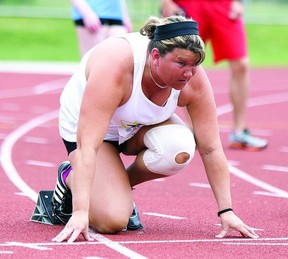 Petrina Dressler has her eyes set on the finish line while she adjusts her blocks at the starting line. Dressler competed in the 100 metre race at the 2013 Ontario Parasport Games held in Kingston from May 29 to June 2.     ERIC HEALY - KINGSTON THIS WEEK