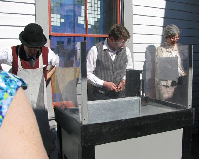 Museums let you explore – guides at the Dawson City Museum conduct a mini gold pour for visitors – an impressive demonstration that involved real gold!