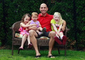 Brad Burleau poses for a photo with his children at his home in Otrleans, On. Friday June 13, 2013. Sitting with thier dad is Cadence, Emersyn and Madison. Tony Caldwell/Ottawa Sun/QMI Agency