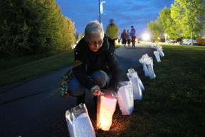 Cheryl Duncan-Molloy lights some luminaries at the Relay For Life that took place in Rotary Park overnight from June 15 to 16. Celia Ste Croix | Whitecourt Star