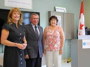 The Seaway Valley Community Health Centre received $6,000 in federal funds for a new fall prevention program. Health promoter Nancy Herrington, left, made the announcement Monday alongside local MP Guy Lauzon and clinic patron Mary Fairbairn. Kathryn Burnham staff photo