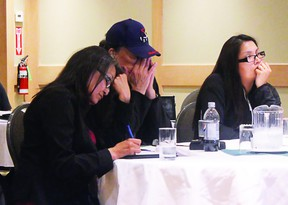 Chief of Naotkamegwanning First Nation, Joyce White (front), sits at her table with other attendees at the Treaty 3 chiefs meeting to discuss the future of the Treaty Three Police Service.