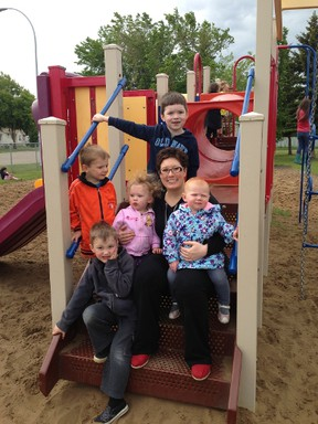 Dayhome owner Sara Johnston poses for a snapshot with the children she cares for. Johnston recently received the provincial Award of Excellence for the category Rural Family Day Home.