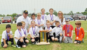 Contributed Photo The Simcoe Kinette Club squirt team won the Simcoe and District Youth Soccer Club's annual Squirt League Tournament championship last weekend. Pictured are, front row: Marco Garcia, Lucas Goncalves, Katie Earle, Lorelei Karges, Evan Smith, Brennan Flexman, Connor Sheppard and  James Trowbridge. Back row: Mark Karges, Gina Barreto, John Trowbridge, Natalie Suprun, Grace Dedrick and Becky Suprun.