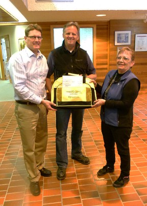 Brent Clair accepts the gift of some Skills Competition bags from GPRC Fairview College Dean of Trades and principal Chris Laue and NW Regional Skills Competiton Coordinator Shirley Lyman after he presented them with a cheque for $3.000.