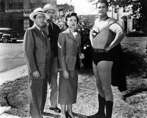 SUBMITTED PHOTO   Superman, played by George Reeves, sweeps in to save the day for Lois Lane (Phyllis Coates) and some good citizens of Metropolis. Reeves wore a grey and white suit when the series was first produced in black-and-white in 1951.