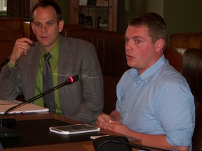 S,D and G roads superintendent Ben de Haan, left, and EDP Renewables project manager Ken Little answer questions from S,D and G council on a local road use agreement for a wind farm project.
