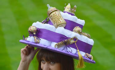 A racegoer arrives for Ladies' Day wearing a hat inspired by the forthcoming royal baby at the Royal Ascot horse racing festival at Ascot, southern England June 20, 2013.  REUTERS/Toby Melville