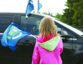 Kids play with flags at the Bruderheim School Drive 4 UR School event put on by Ford Canada. The event was held to help raise money for a playground at the elementary school. Photo by Aaron Taylor.