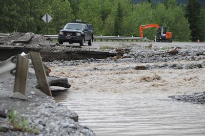 The 1A Highway was washed out early this morning just east of Exshaw, Alta. on June 20, 2013 after water from the Jura River proved too much for the road. Stuart Dryden/Calgary Sun/QMI Agency