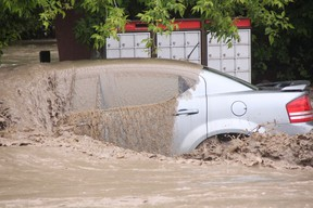 KEVIN RUSHWORTH HIGH RIVER TIMES/QMI AGENCY. High River continues to suffer through its worst flooding in decades. Pictured above, a car is mere moments away from being sucked away by the force of the Highwood River.