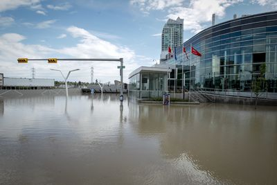 The intersection of 9 Ave and 4 St SE remains under massive flood waters in Calgary, Alta. on Saturday, June 22, 2013. Massive flooding two days earlier destroyed lives and homes throughout southern Alberta. Lyle Aspinall/Calgary Sun/QMI Agency