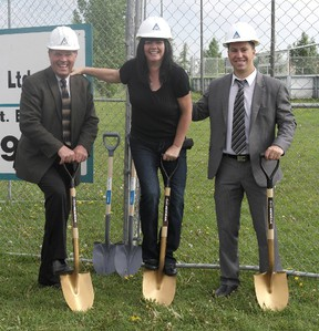 Callingwood/Lymburn community league president Terry Demers (centre) poses with representatives from Hendricks Construction at the future site of the Callingwood/Lymburn community hall in West Edmonton, on June 21, 2013. Photo Supplied.