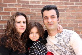 Ganimete Berisha, 29, left, and her husband Muhamet Bajraktari, 36, have worked since arriving in Canada in 2007, but worry about their future and that of their daughter, Eliza, as they face deportation to Kosovo. Photo take Sunday, May 5, 2013, in Chatham, Ont. (ELLWOOD SHREVE/ THE CHATHAM DAILY NEWS/ QMI AGENCY)