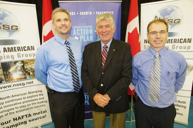 MP Dave MacKenzie, centre, with North American Stamping Group general manager Fred Gehring, left, and sales manager Ken Schlimme at the announcement of a $10.9 million operations expansion. HEATHER RIVERS/WOODSTOCK SENTINEL-REVIEW