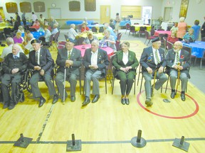 Veterans, from left, Lloyd Hughes, Hilbert Lechelt, Andy Nelson, Max Pfannmuller, June Watt, Alex McCallum, and Bud Schaupmeyer are the honoured guests at the 80th anniversary of the  Mayerthorpe Royal Canadian Legion Branch 126 on Saturday, June 22.